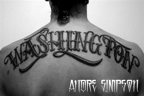 tattoo typography and black omerta lettering on back by