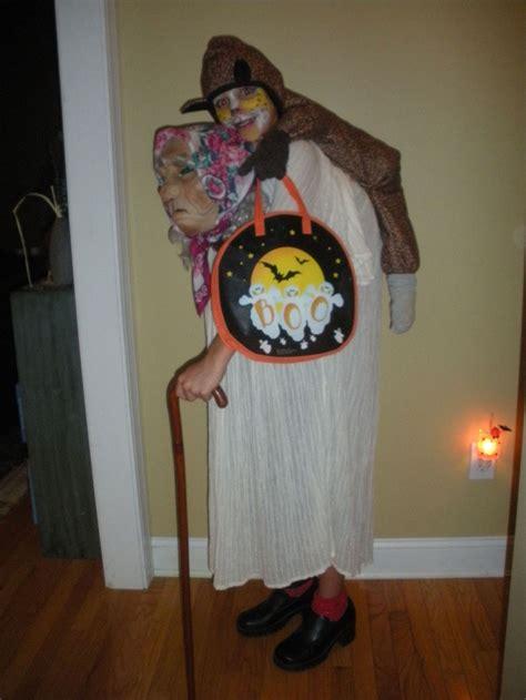 woman giving  piggy  ride goodwill halloween