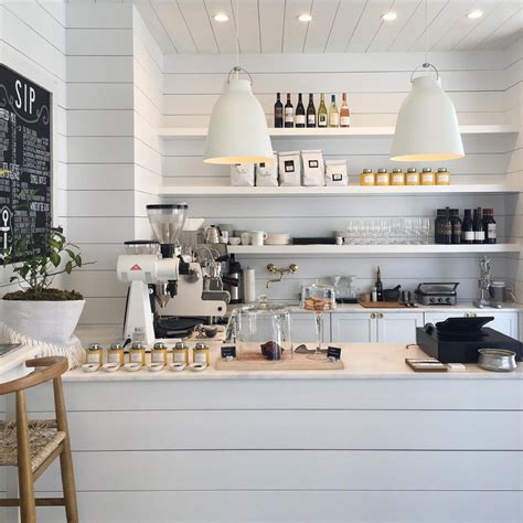 whitening shoo bright white coffee shop retail store in florida called outpost shiplap wall