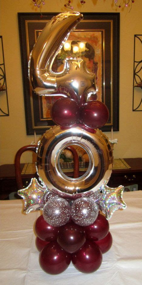 Elegant balloon centerpiece in gold, burgundy and silver