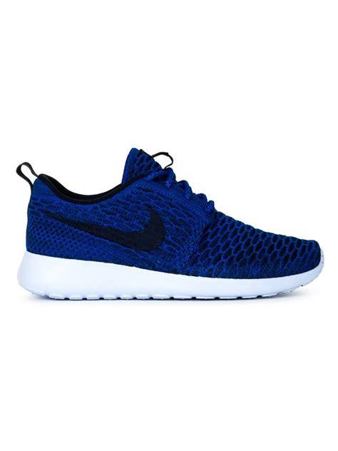 nike blue sneakers nike roshe one flyknit sneakers in blue lyst