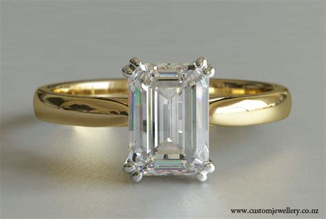 emerald cut solitaire engagement ring in yellow