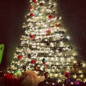 tree made of lights on wall hang lights on the wall and hook ornaments onto