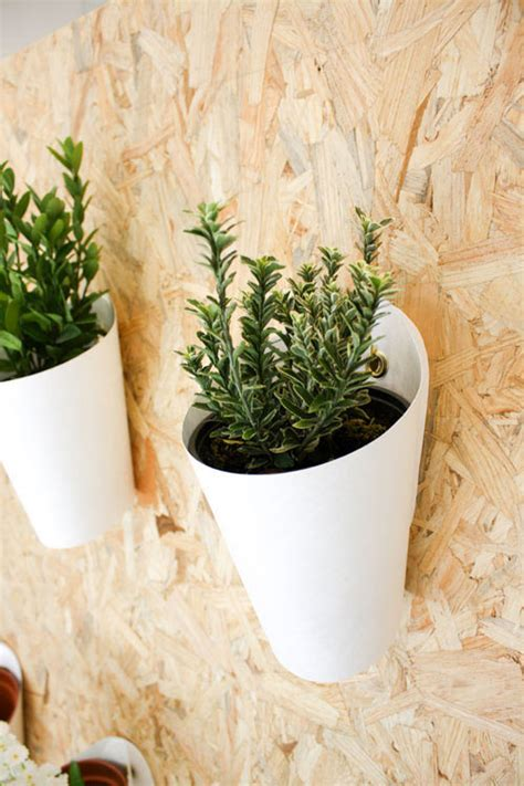 opot modern wall mounted planter by clara del portillo
