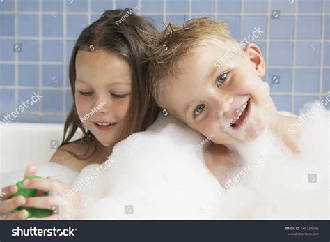 sister brother bathroom brother sister taking bath stock photo 180734696