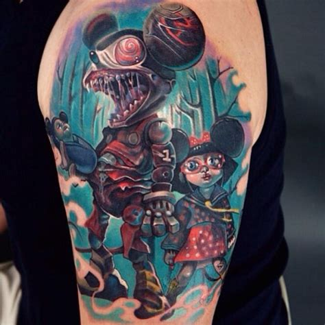 tattoo cartoon style colored cartoon style shoulder tattoo of creepy mouse
