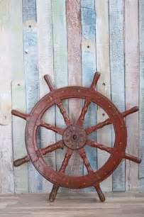 Nautical Themed Outdoor Decor - nautical decor ideas enhanced by vintage ship wheels and handmade themed decorations