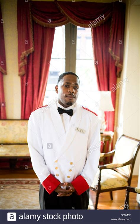 a portrait of a bellman at a hotel stock photo