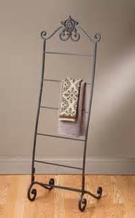 Bathroom towel racks with wrought iron frame along with gray bathroom