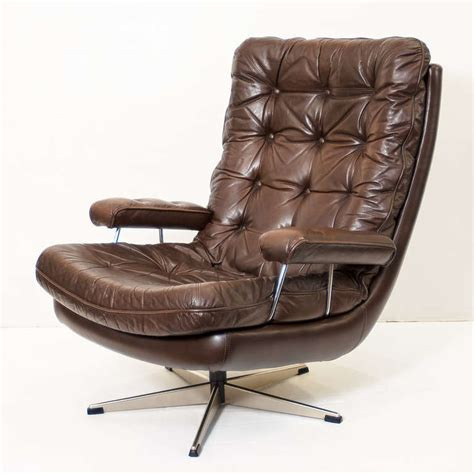 Swivel Leather Chairs by Swivel Lounge Chair Of Tufted Leather One