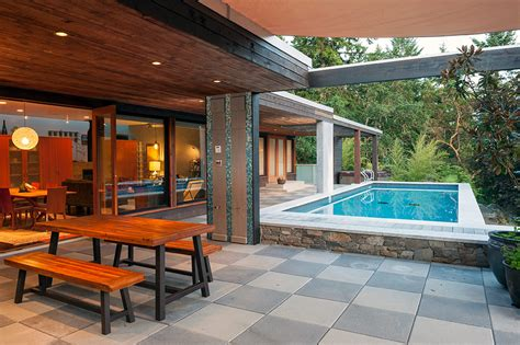 luxurious indoor and outdoor oasis pool house by icrave outdoor eco pool elevates this modern home to luxury oasis