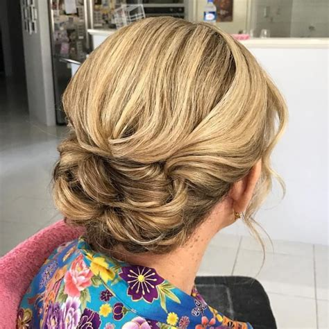 casual updo 60 yr olds 40 stylish long hairstyles for older women twist bun