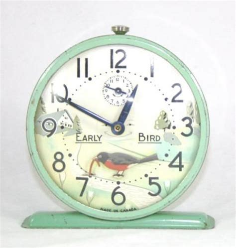 early bird alarm clock and worms on