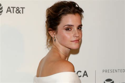 emma watson quot the circle quot press tour portraits in paris emma watson risked wardrobe malfunction in low white gown