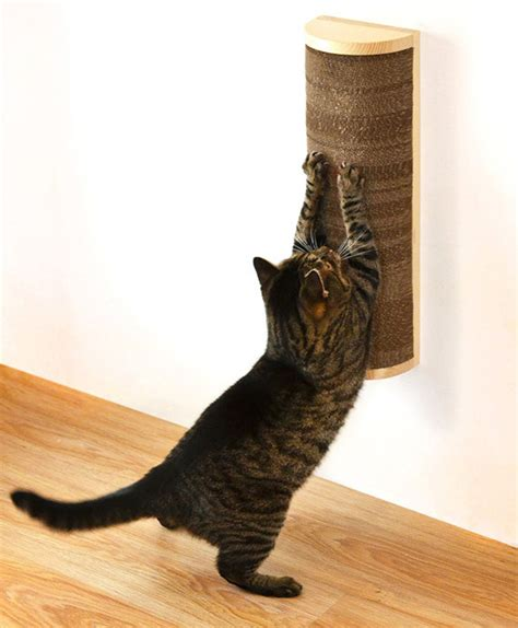 Cat Scratching by Save Space In Style With These Wall Mounted Cat Scratchers