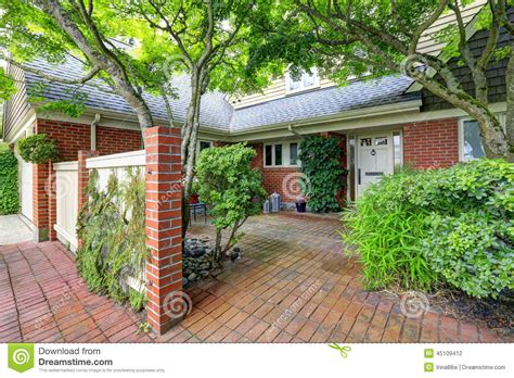 brick wall front yard brick house exterior with tile floor front yard stock