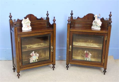 pair of small rosewood display cabinets 268333