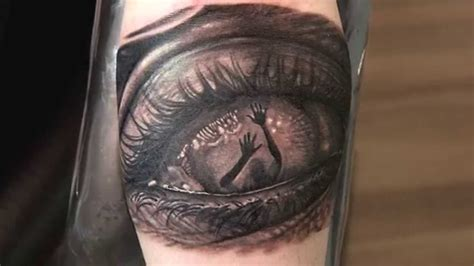 eye tattoo black 42 unique horror tattoos