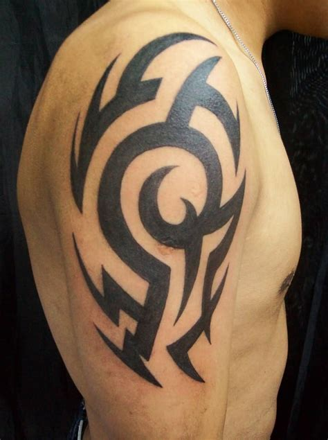black ink famous tribal tattoo on upper arm for guys