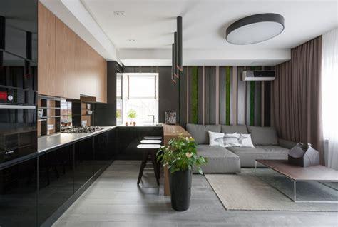 Dunkles Wohnzimmer by Riba House By Svoya Studio