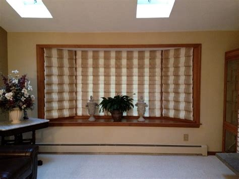 window treatments for bay windows in living room hobbled roman shade for bay window