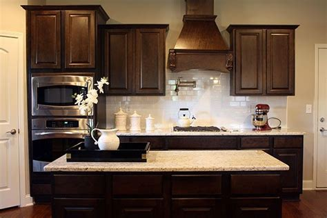 dark kitchen cabinets with backsplash dark cabinets white subway tile backsplash and revere