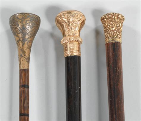 antique walking stick or that two antique walking sticks and a parasol frame 09 08 12
