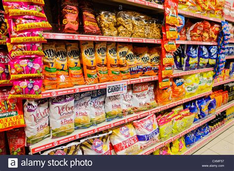 Sale Snack packets of branded snack and crisps on sale on the shelves