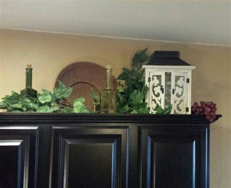 decorating above kitchen cabinets tuscan style tuscan decor above cabinets decorating pinterest