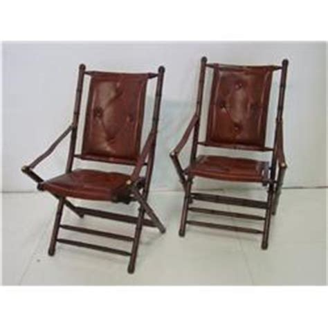 pair leather faux bamboo fold up chairs