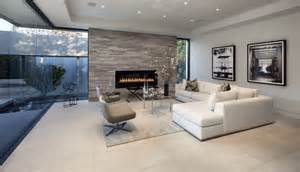 This ultra modern family room pairs a white l shaped contemporary
