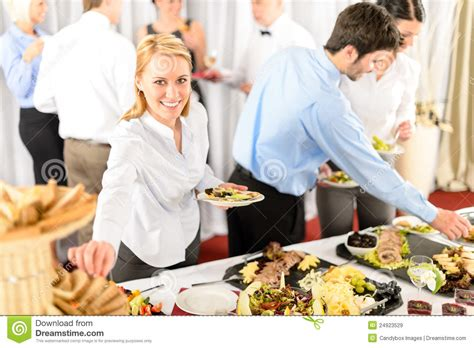 business woman serve herself at buffet stock image image