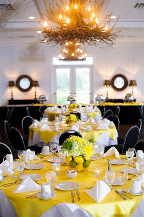 lemon lime wedding table centerpieces with forest green or gold tablecloth not yellow