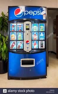 pepsi vending machine a coin operated pepsi vending machine dispensing cans of