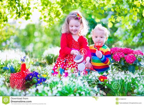 Baby Toddler Bed Kids little kids working in the garden stock photo image