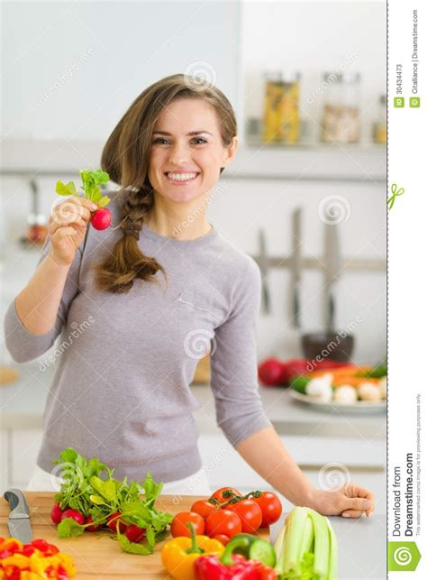 How To Plan A Kitchen Design Happy Housewife In Kitchen Showing Radish Stock Photos