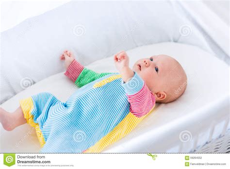 baby boy in a white crib stock photo image 59264552