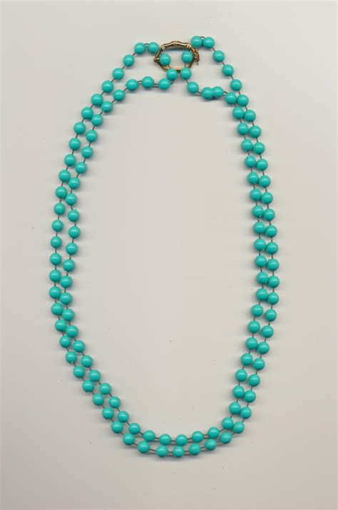 one bead necklace a or four strand bead necklace made of one necklace