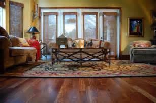 caribbean rosewood hardwood floor tropical living room ta by through the woods fine