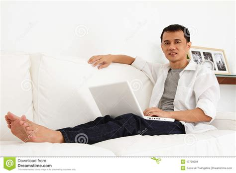 asian working on laptop at home stock images image