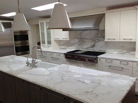 kitchen backsplash granite a remodeled kitchen with a slab of granite island matching