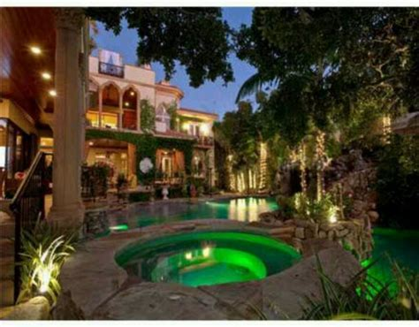 dream house a pool in the front of the house is a bit dream house pool at night dream houses pinterest