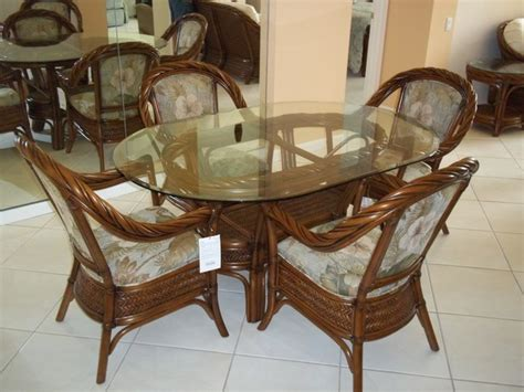 oval glass top dining table  rattan chairs