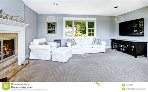 Stock Interiors Carpet by Light Blue Living Room With White Sofa And Fireplace Stock