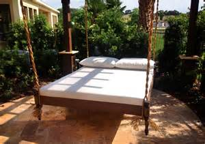 Round patio coffee table design with unique outdoor hanging bed plus