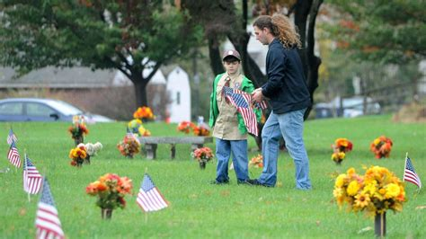 cub scouts place flags on veterans at bel air