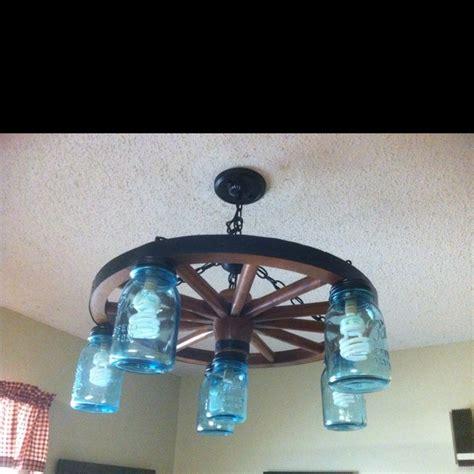 wagon wheel light with jars wagon wheel and jar light craft ideas
