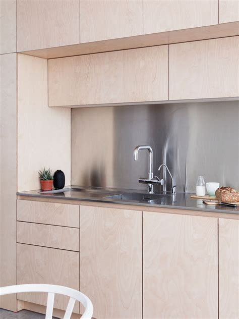 light wood cabinets  stainless steel countertops