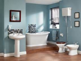 The bluish bathroom wall is accented with white sink bathtub and
