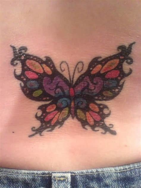 butterfly tattoo cover up designs lady lower back cover up with colorful butterfly tattoo